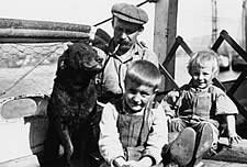 Photo taken in 1911 aboard the St. Katherine - with the captain, his children and his dog Queen